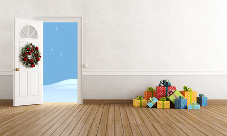 foyer: White room with open door with christmas present on wooden floor Stock Photo