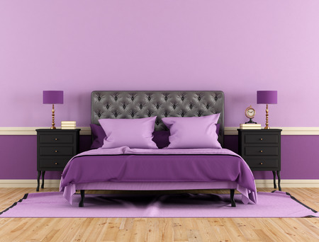 Black and purple bedrrom with double bed and nightstand