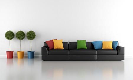Современная гостиная с черный диван и красочные подушки