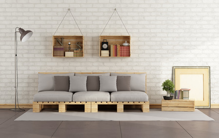 minimalist apartment: Living room with pallet sofa and wooden crate with books on brick wall - 3D Rendering