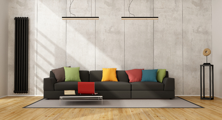 radiator: Black sofa with colorful cushion in a concrete room - 3D Rendering Stock Photo