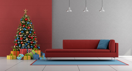 Red and gray living room with christmas tree,colorful gift and red couch - 3d rendering