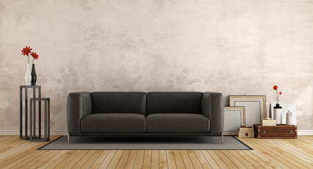 frame wall: Black modern sofa in a living room with old wall and retro objects - 3d rendering