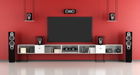 home cinema: contemporary red and black home cinema system - 3d rendering Stock Photo