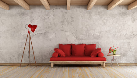 Red sofa in a grunge room,with old wall and wooden ceiling