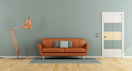 Blue living room with orange sofa , closed door and wall lamp - 3d rendering Banque d'images