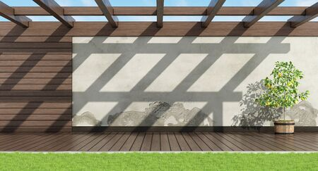 Home garden with old wall, wooden paneling and pergola - 3d rendering Standard-Bild