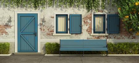 Facade with old brick wall,blue door , windows and bench - 3d rendering Standard-Bild