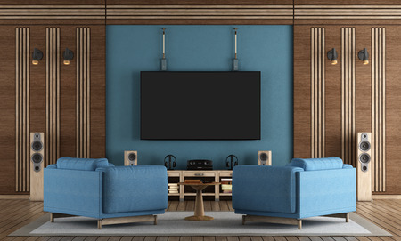 home cinema room with TV hanging on blue wall ,armchairs and wooden decorations - 3d rendering Standard-Bild