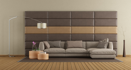 Modern living room with brown sofa against leather panels - 3d rendering Stock Photo