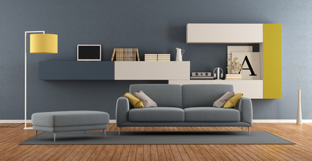 Modern living room with blue sofa and colorful bookcase on background - 3d rendering Фото со стока