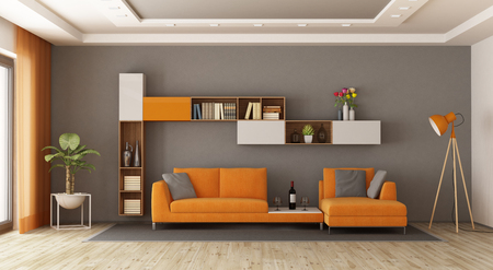 Gray and orange living room with sofa and bookcase - 3d rendering Imagens