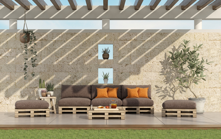 Garden with pallet sofa and wooden pergola with stone wall on background - 3d rendering Banque d'images - 117603264