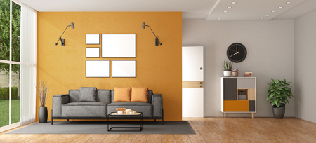 Living room of a modern villa with gray sofa against orange wall and front door on background - 3d rendering Imagens