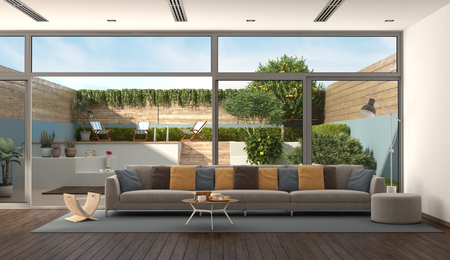 Living room of a modern villa with colorful sofa and garden on background - 3d rendering Banque d'images - 121499206