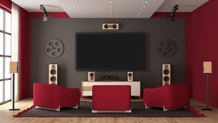 Modern home cinema with flat tv, audio equipment and three red armchair - 3d rendering