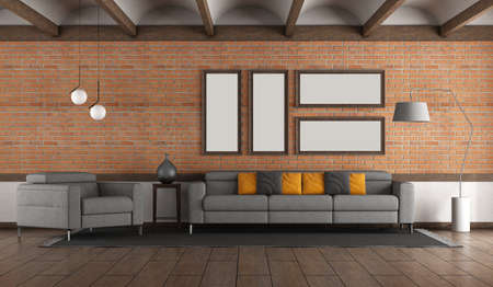 Living room with brick wall .gray sofa and armchair and voulted ceiling 免版税图像