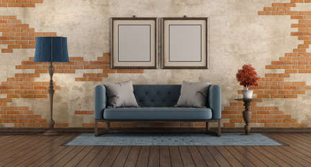 Living room with blue classic sofa, floor lamp and picture frane agaist old brick wall - 3d rendering