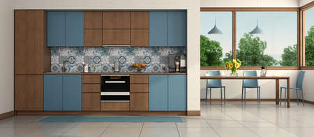 Modern blue and wooden kitchen with ding table and chair on background - 3d rendering 免版税图像