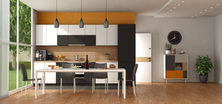 Modern black and white kitchen against orange wall, with dining table, open door and sideboard on background - 3d rendering 免版税图像