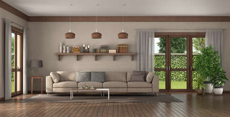 Elegant sofa in a large living room with wooden shelf with books on background - 3d rendering