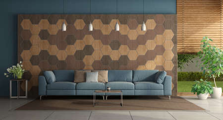 Modern living room with blue sofa in front of a wall with hexagonal wooden tiles - 3d rendering 免版税图像