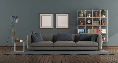 Blue living room with modern sofa and bookcase on background - 3d rendering 免版税图像