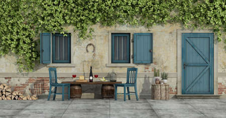 Courtyard of an old country house with chairs and food on a wooden bench - 3d rendering 免版税图像