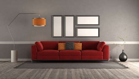 Living room with modern red sofa, empty picture frame and floor lamp - 3d rendering Stockfoto