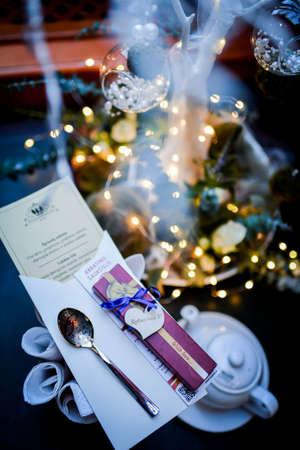Wedding invitations on the table and nice christmas lights 免版税图像