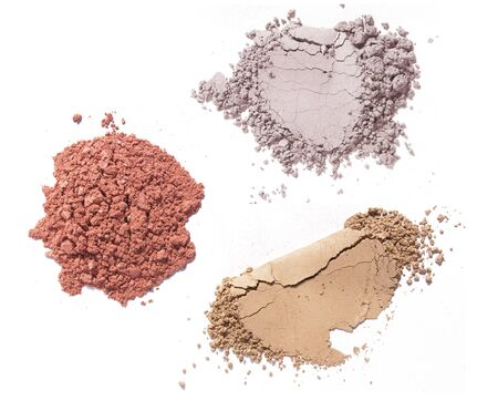 various color makeup powders on white background