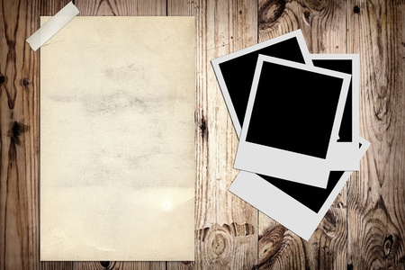 Blank photo and old poster on wooden background Stock Photo