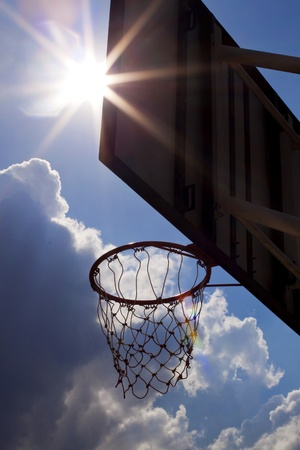 Basketball board with lens flares of sunlight Stock Photo