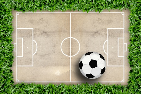 Soccer field pattern and football in green grass frame photo