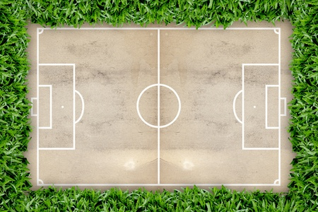 Soccer field pattern on grunge paper background in the green grass frame photo