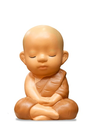 Earthenware of child monk isolated on white background