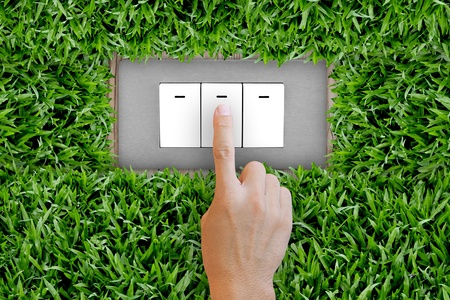 Pressing switch button in the nature Stock Photo