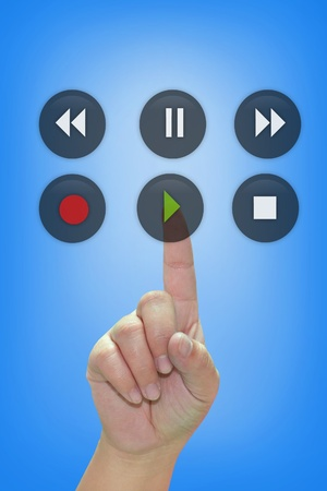 pause button: Hand pressing audio button Stock Photo