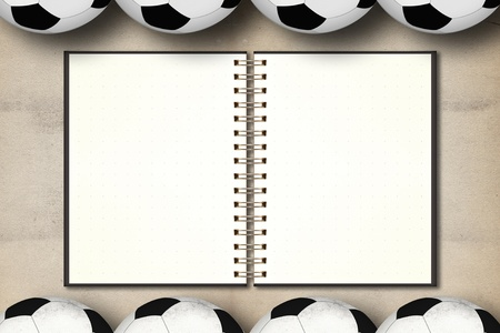 Blank notebook in framing of football on grunge vintage background photo