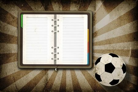 radius: Football and blank notebook on grunge vintage background