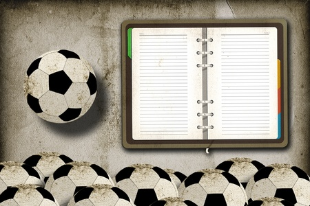 Football and blank notebook on grunge vintage background