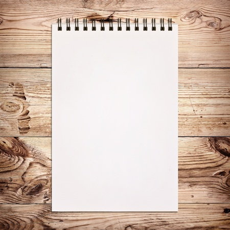 old notebook: White notebook for painting on wooden background Stock Photo