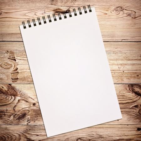 White notebook for painting on wooden background Фото со стока