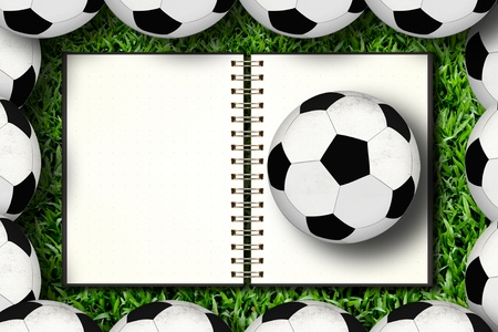 Notebook and soccer in framing photo