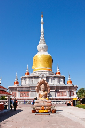 White pagoda and buddha sculpture seven headed cobra in temple of thailand