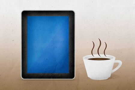 Tablet pc with coffee, Paper craft from recycled paper photo