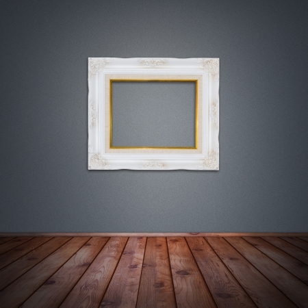 Photo frame on the wall in vintage room background Фото со стока