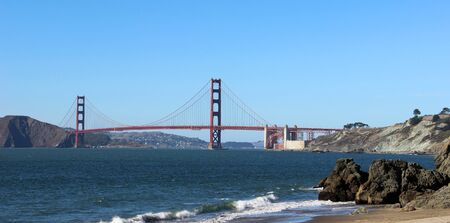 The Golden Gate Bridge, California, United States of America. View on the beach from a sunny summer day.