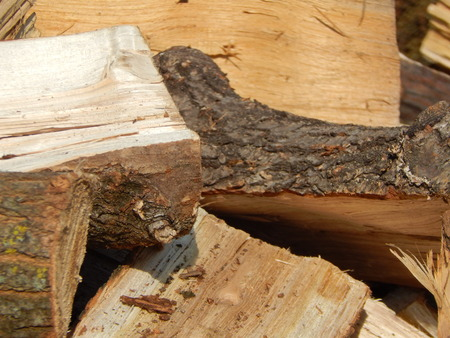 Firewood for the heating of the house in the oven Stock Photo