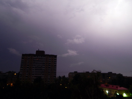 Lightning and thunder at night in the city its raining